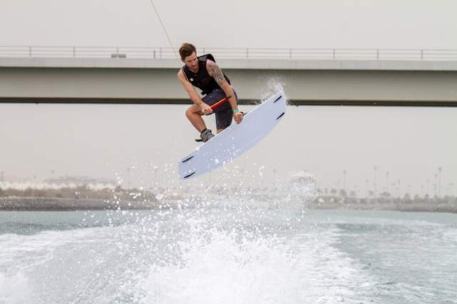 Jeff McKee doing a method grab while wakeboarding.