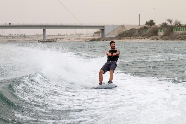 Jeff McKee wakeboarding behind the boat.